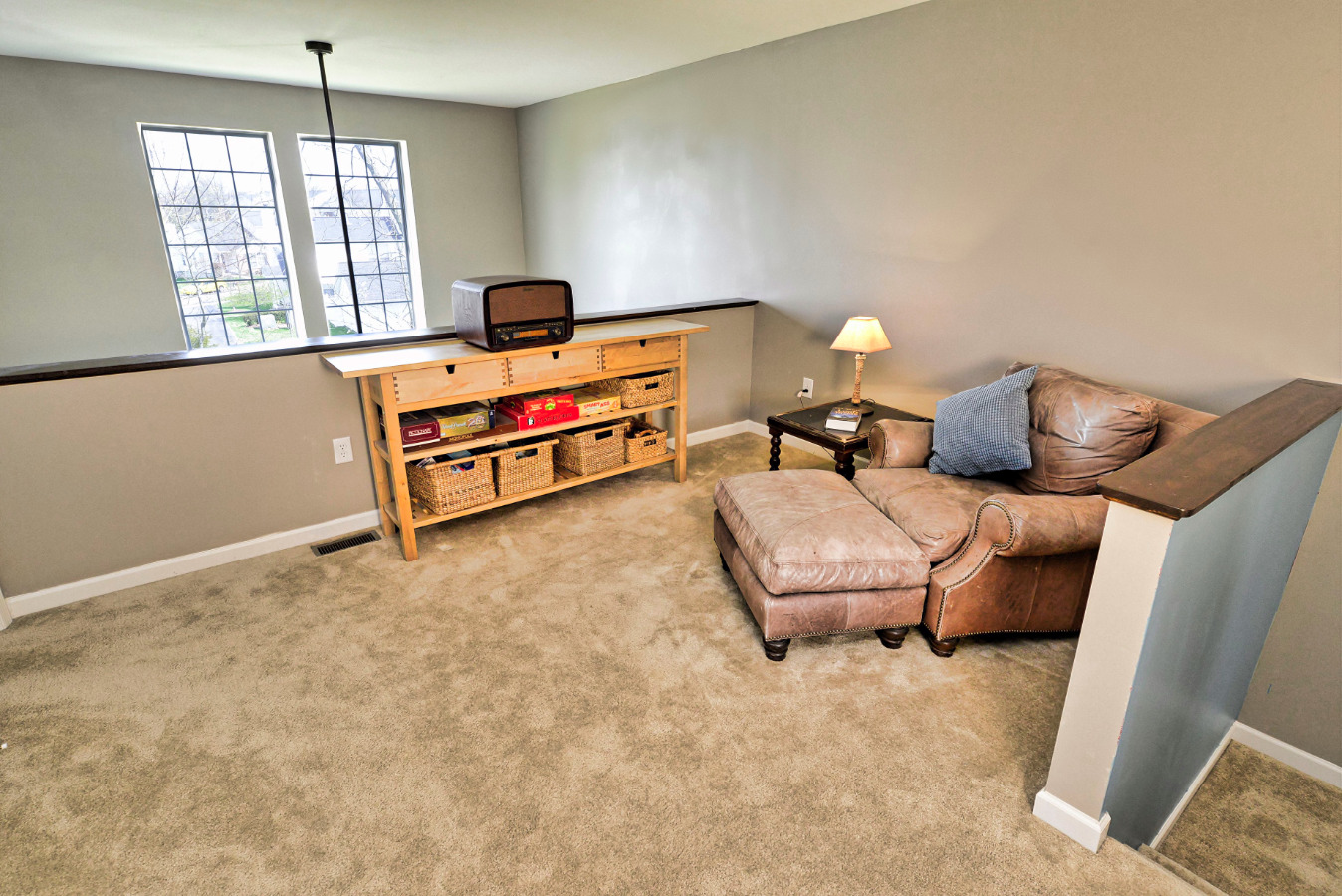 Upstairs is an open bonus room/large reading area. Perfect for quiet evenings wi