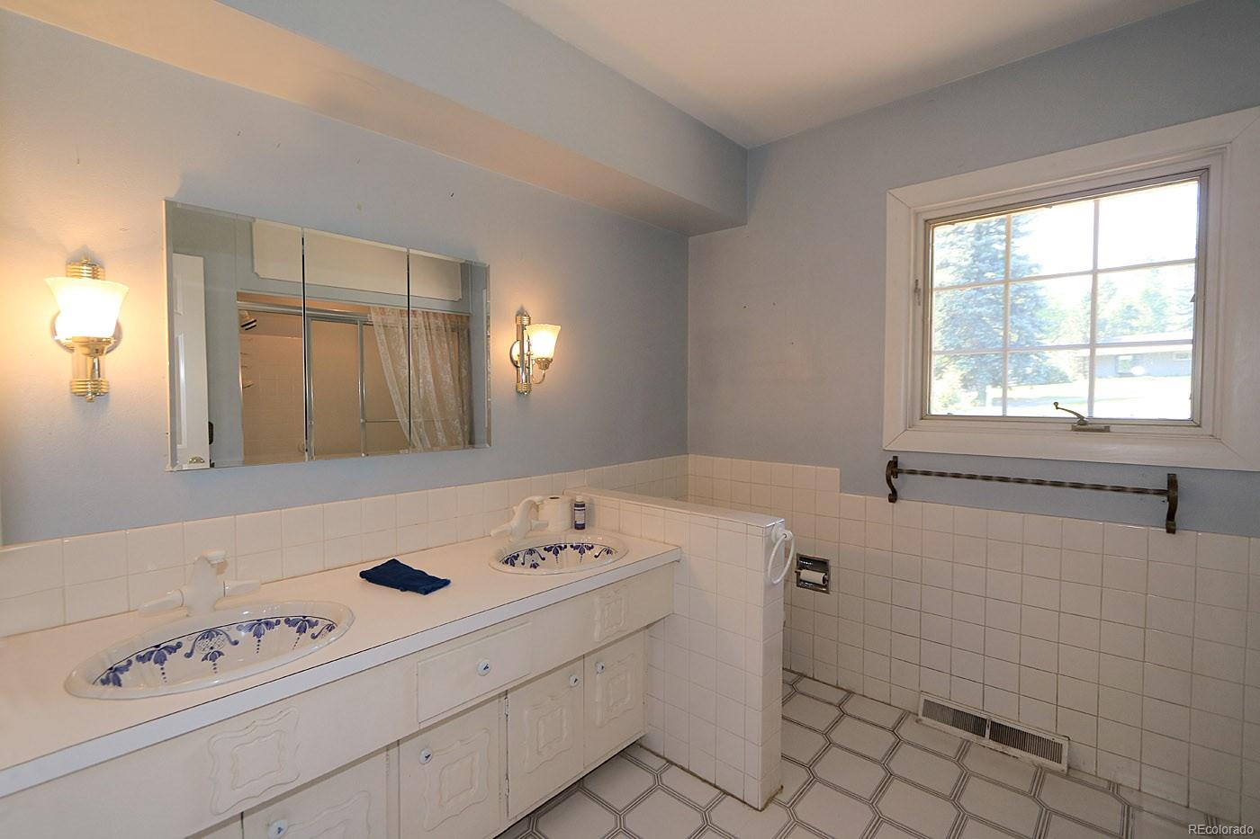 Guest Bath features large vanity area with 2 sinks