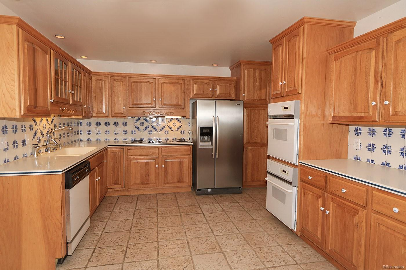 Large Kitchen With Eat-In Area For Table