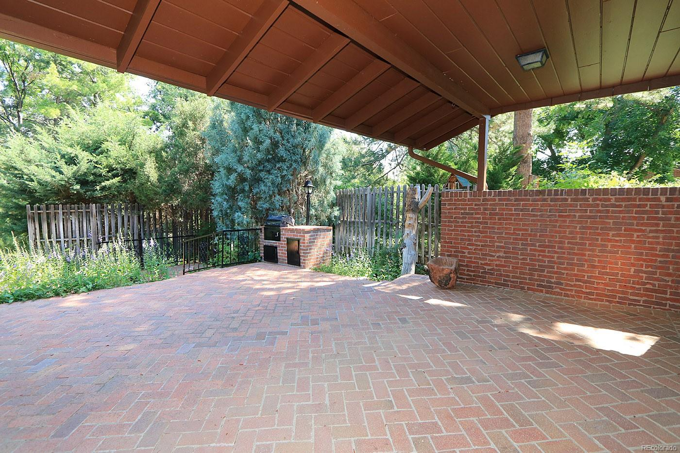 Family Room Opens to Partially Covered Brick Patio