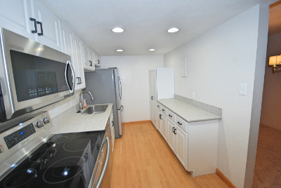 White cabinets with a full pantry