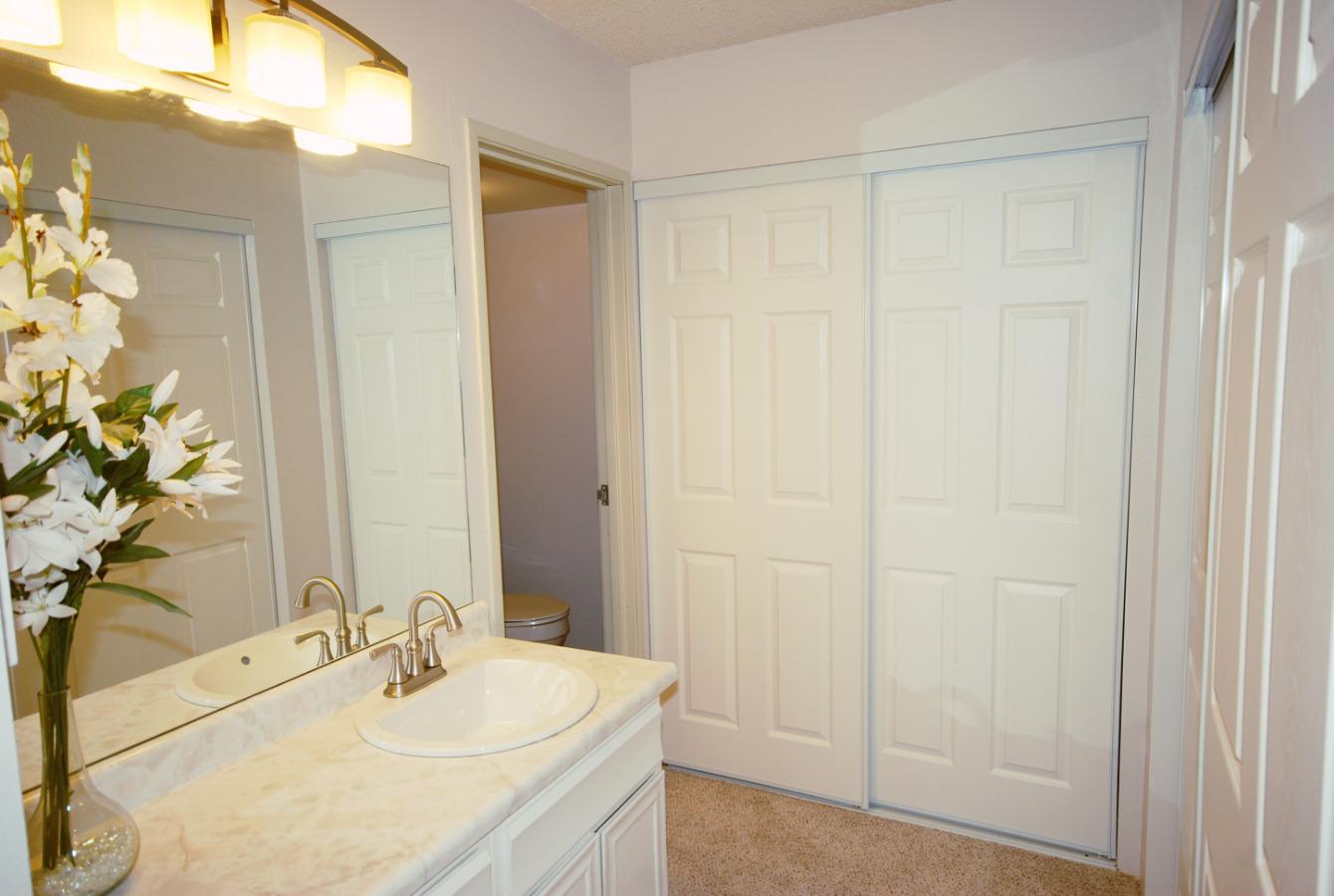 Master bath with 2 full closets