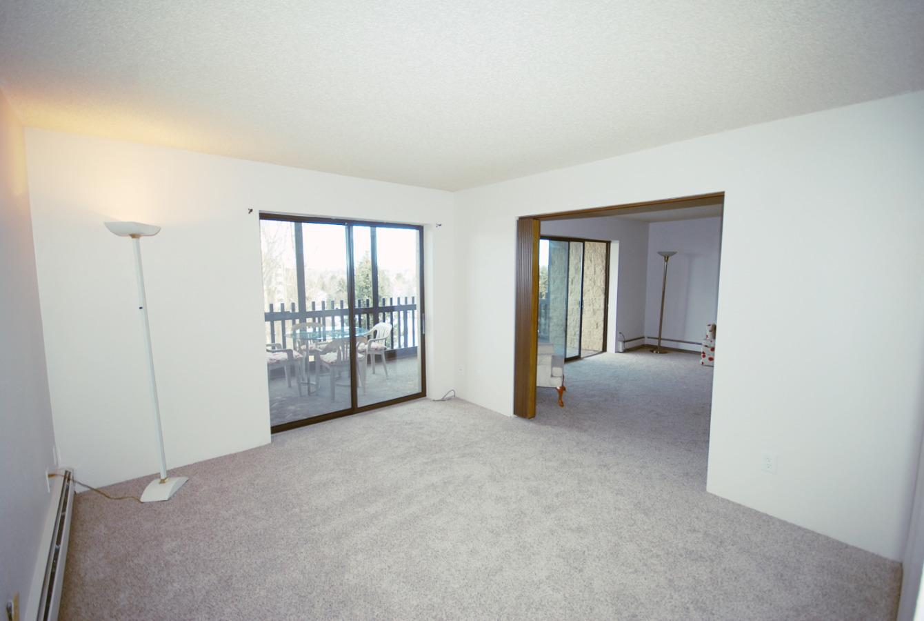 Den with sliding door to balcony