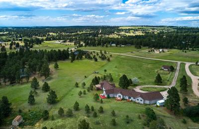 Sprawling Ranch with oversized 3 car garage positioned for maximum benefit of the 5.16 acres!