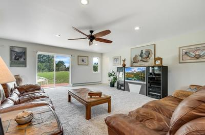 Family Room has great light and access to backyard with a deck to enjoy the country atmosphere.