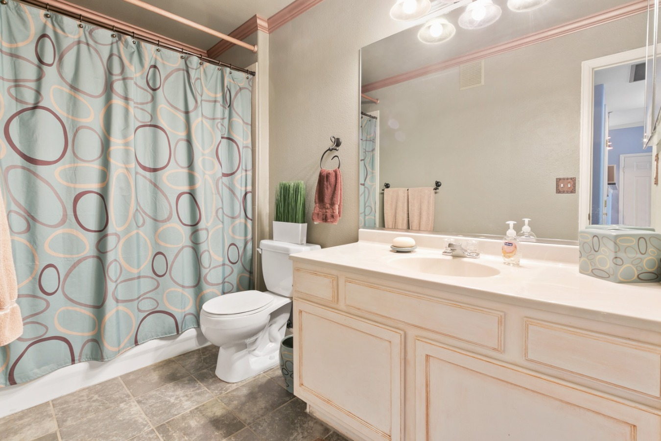 Master Bathroom has great tile flooring and storag