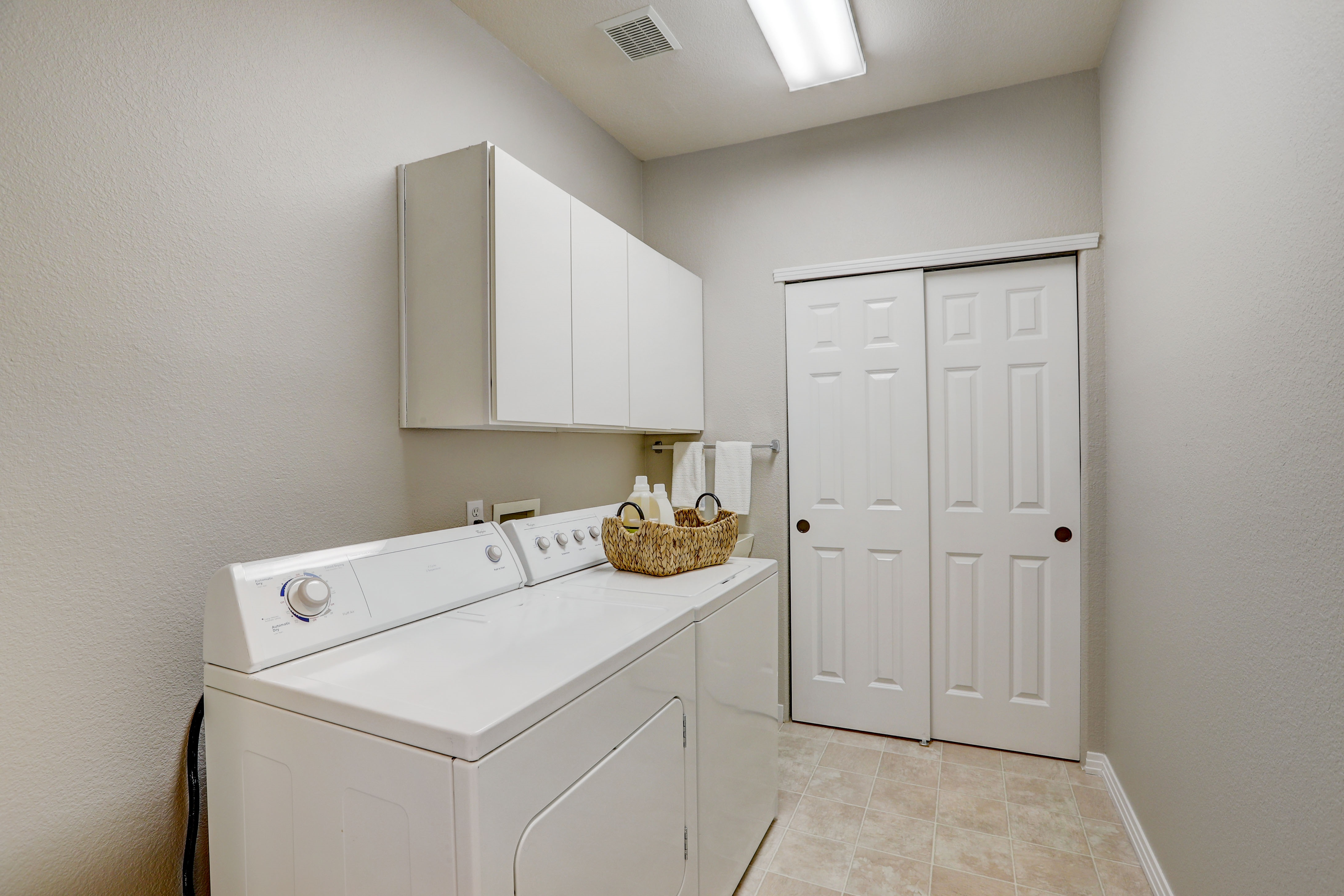 Laundry with Utility Sink and Closet