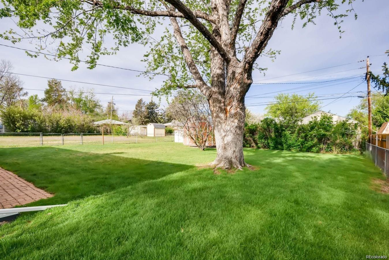 View adjacent neighbors yard for  lot on Beach Court