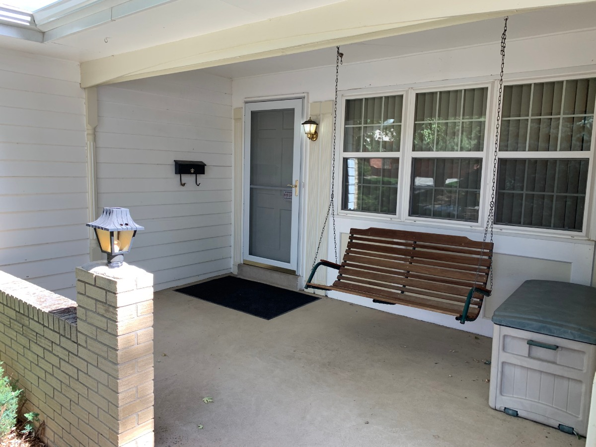 Cozy Covered Front Porch with Swing