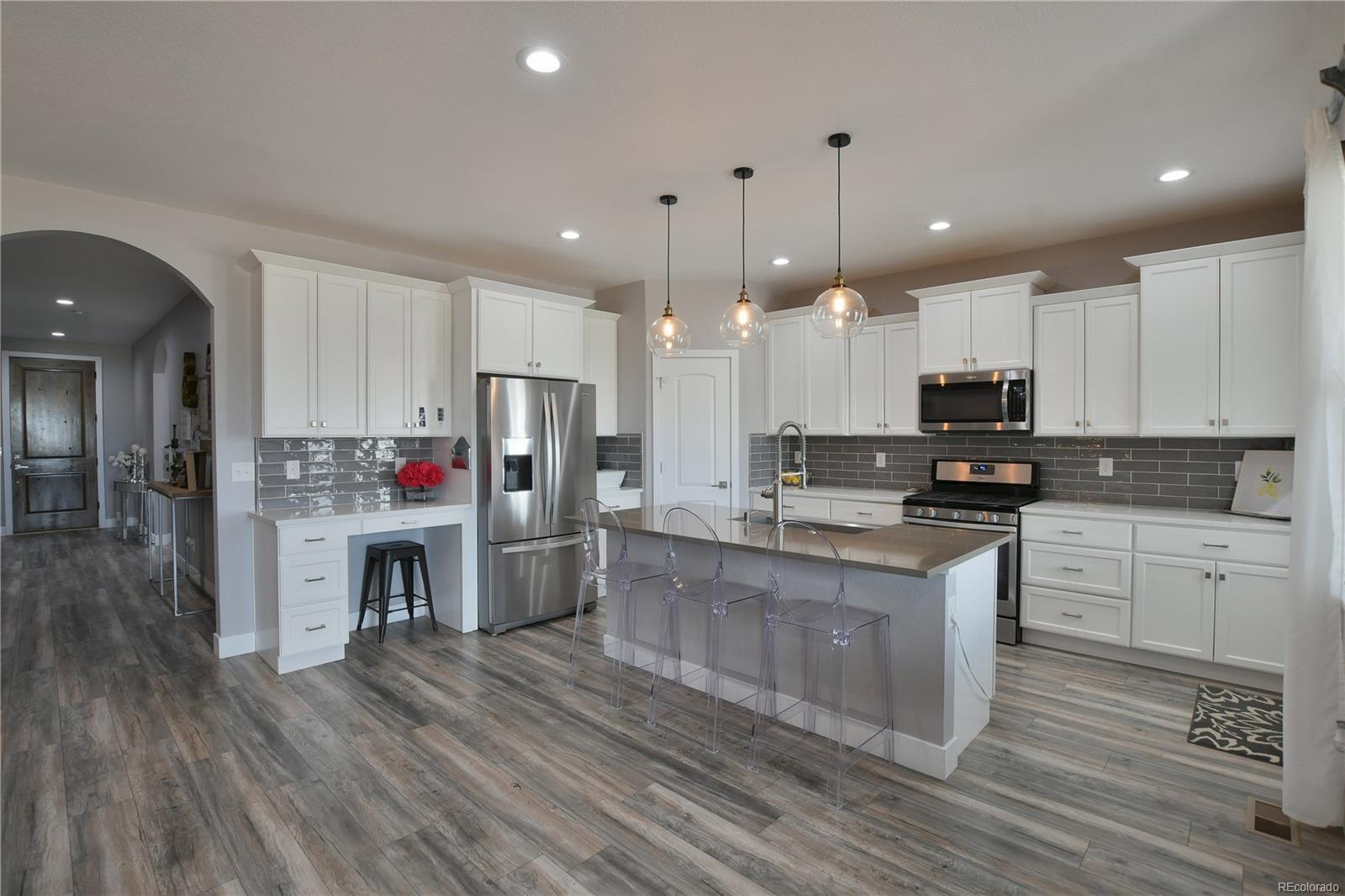 Quartz counters, farm sink, stainless appliances, recessed lighting