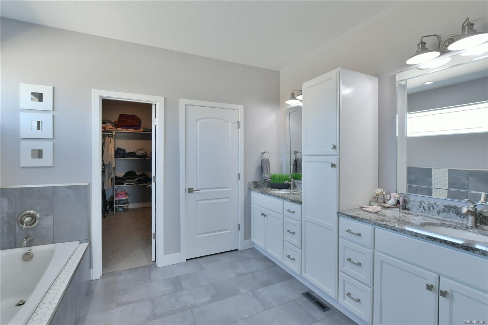 Double vanity, quartz counters, large walk in closet and lots of storage!