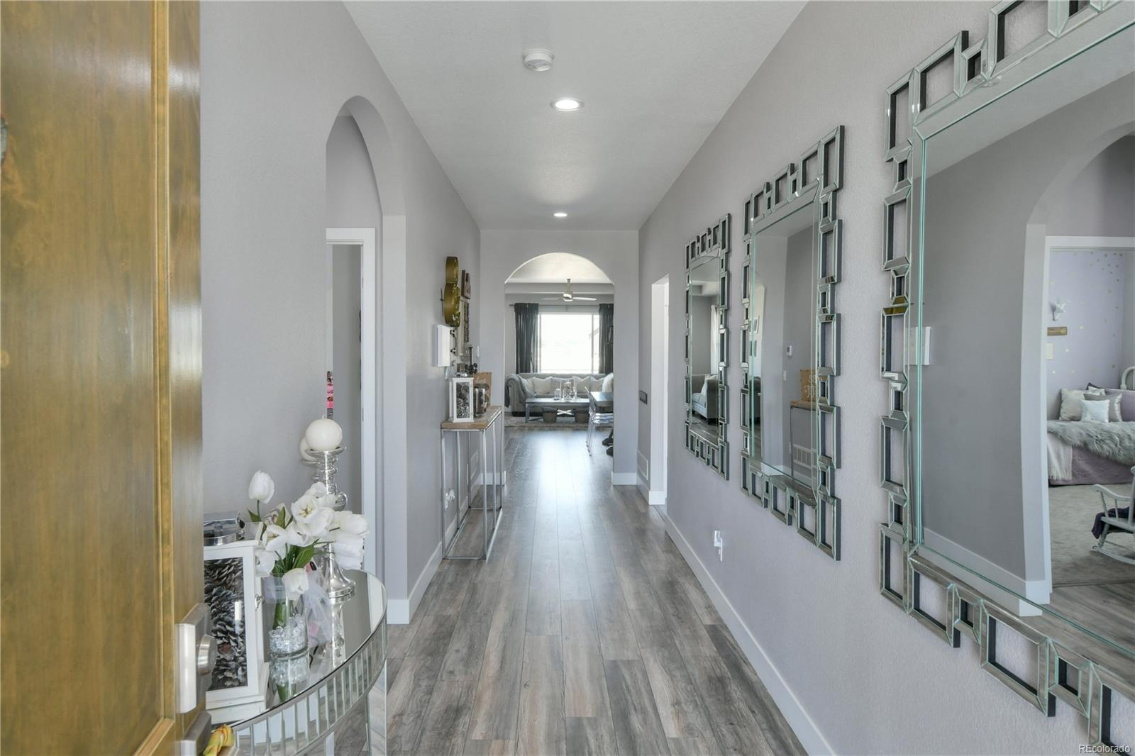 Gorgeous waterproof laminate plank flooring throughout entire living area, lifetime warranty