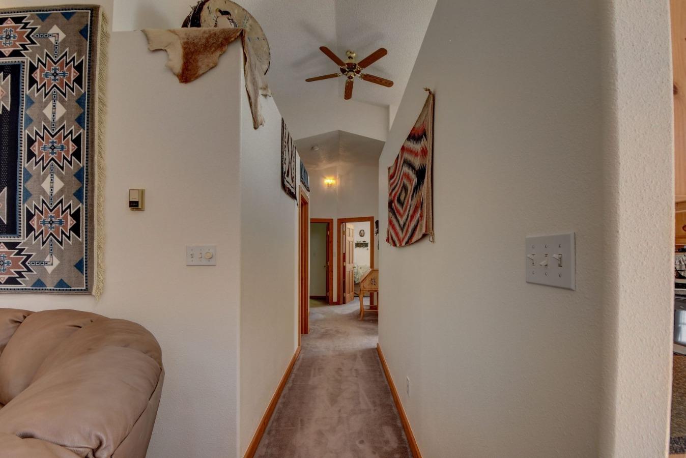 Hallway to bedrooms and bath
