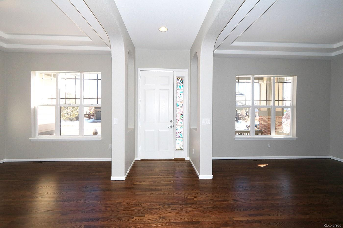 Stunning Entry Leading Into Living & Dining Room