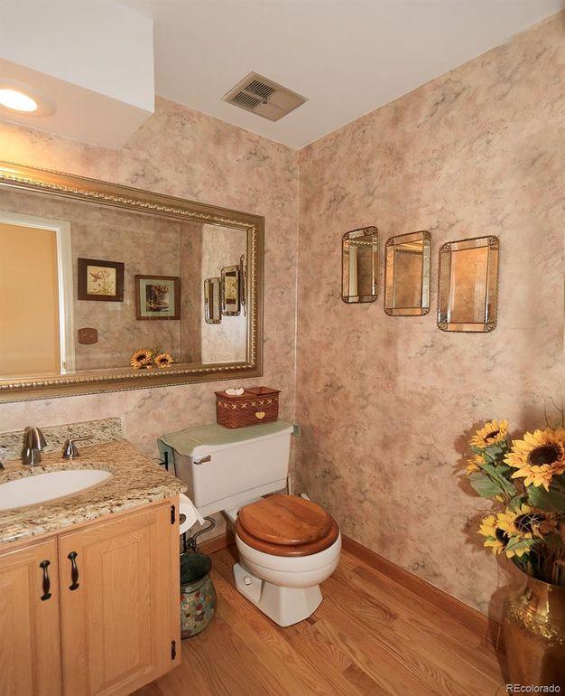 Main floor half bath, wood floors