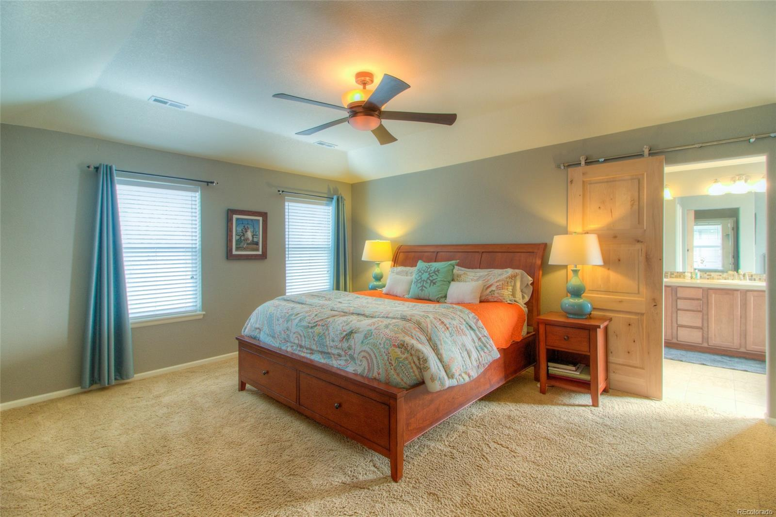 Huge Master Bedroom with in-lay ceiling and barn door to master bath