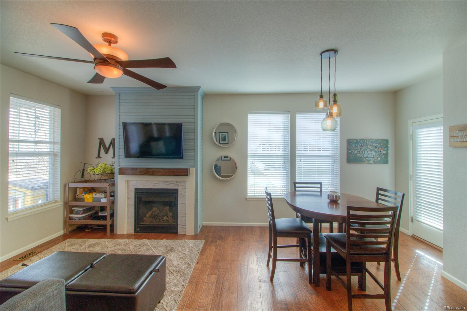 Fabulous open main floor with wood floors and custom gas fireplace