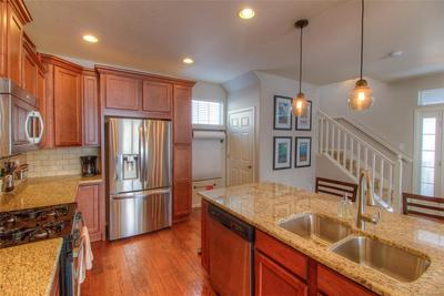 Fabulous open main floor features this gorgeous Kitchen