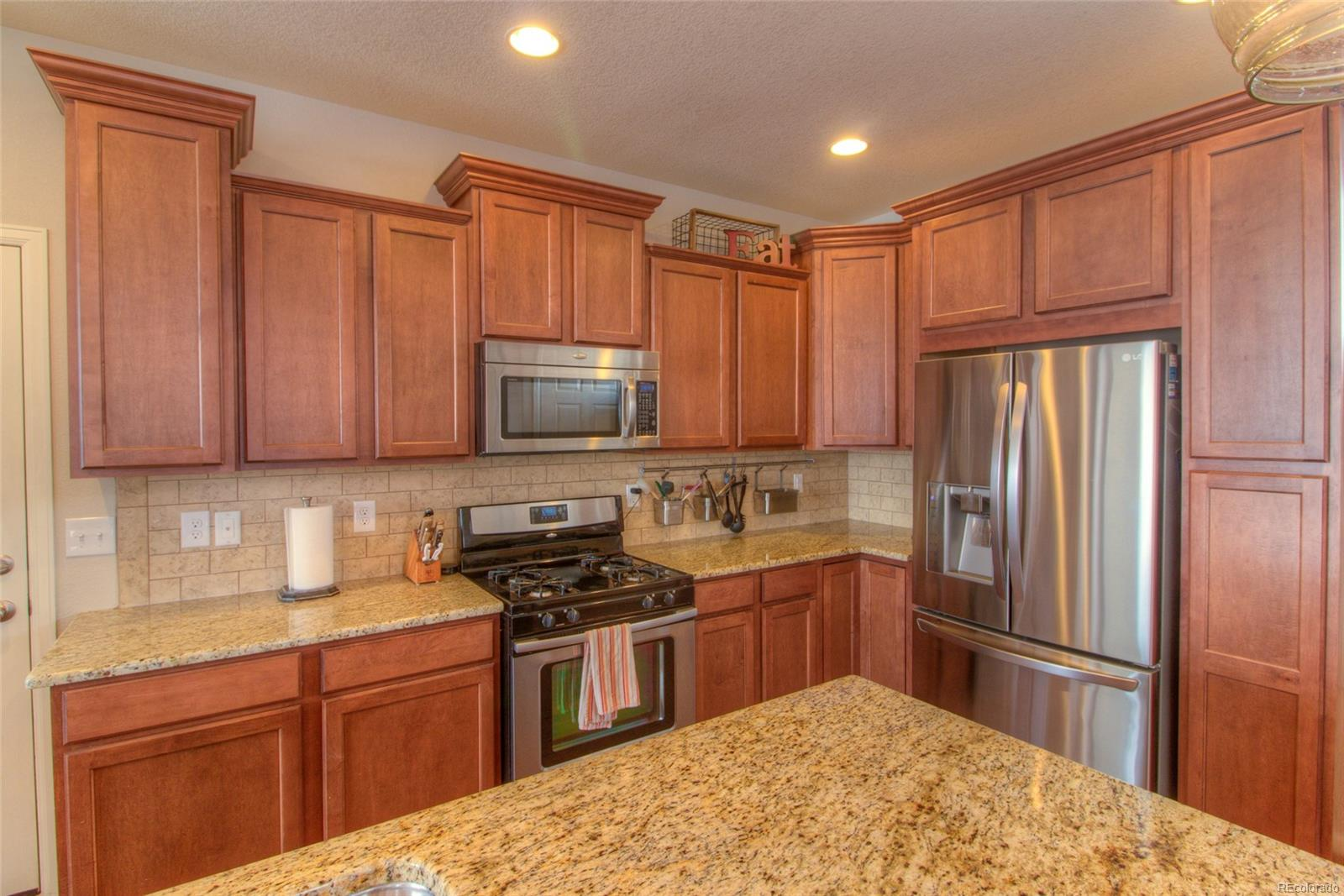 Granite countertops, stainless steel appliances including gas stove top