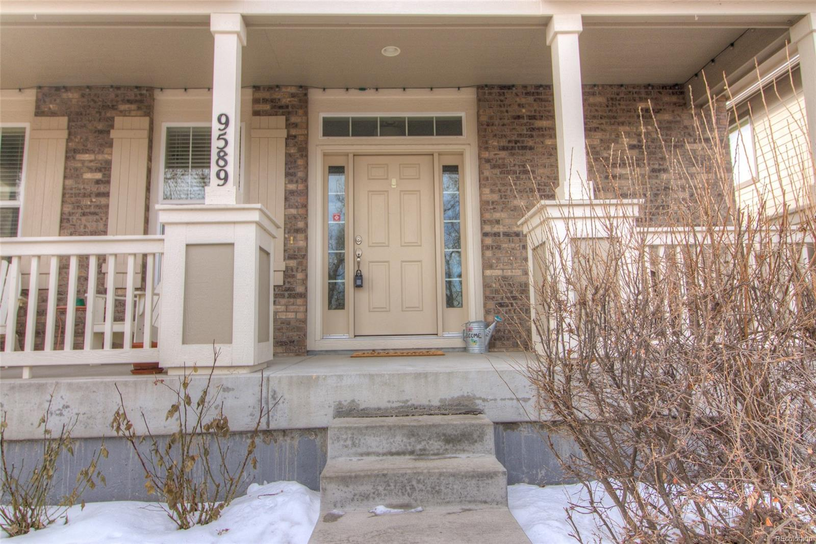 Wonderful private covered front porch overlooking the treed area of the Nevin/Fa