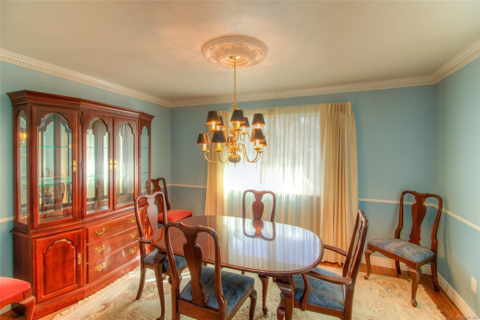 Formal dining room with crown molding and refinished hardwood floors