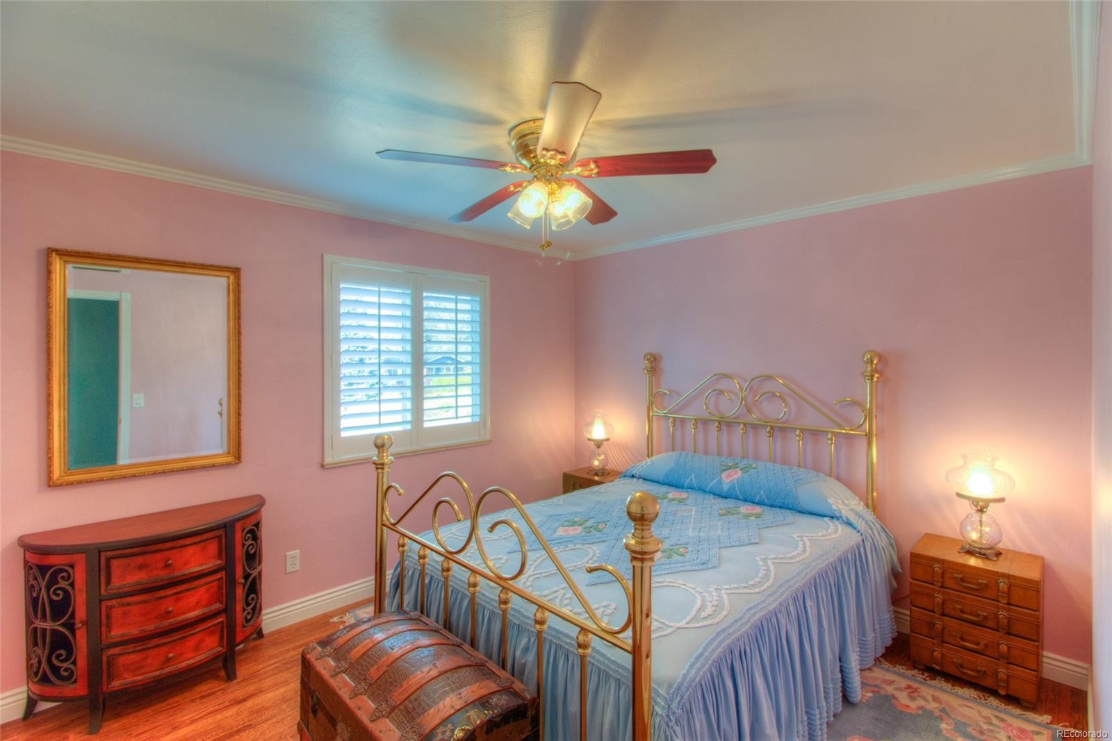 2nd Full Bedroom upstairs with crown molding, plantation shutters and hardwood floors