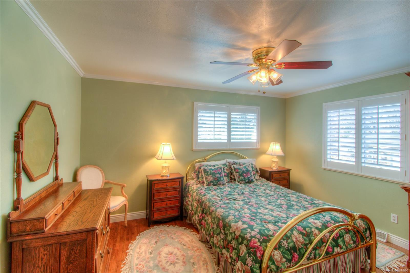 3rd Bedroom upstairs with crown molding, plantation shutters and those beautiful wood floors