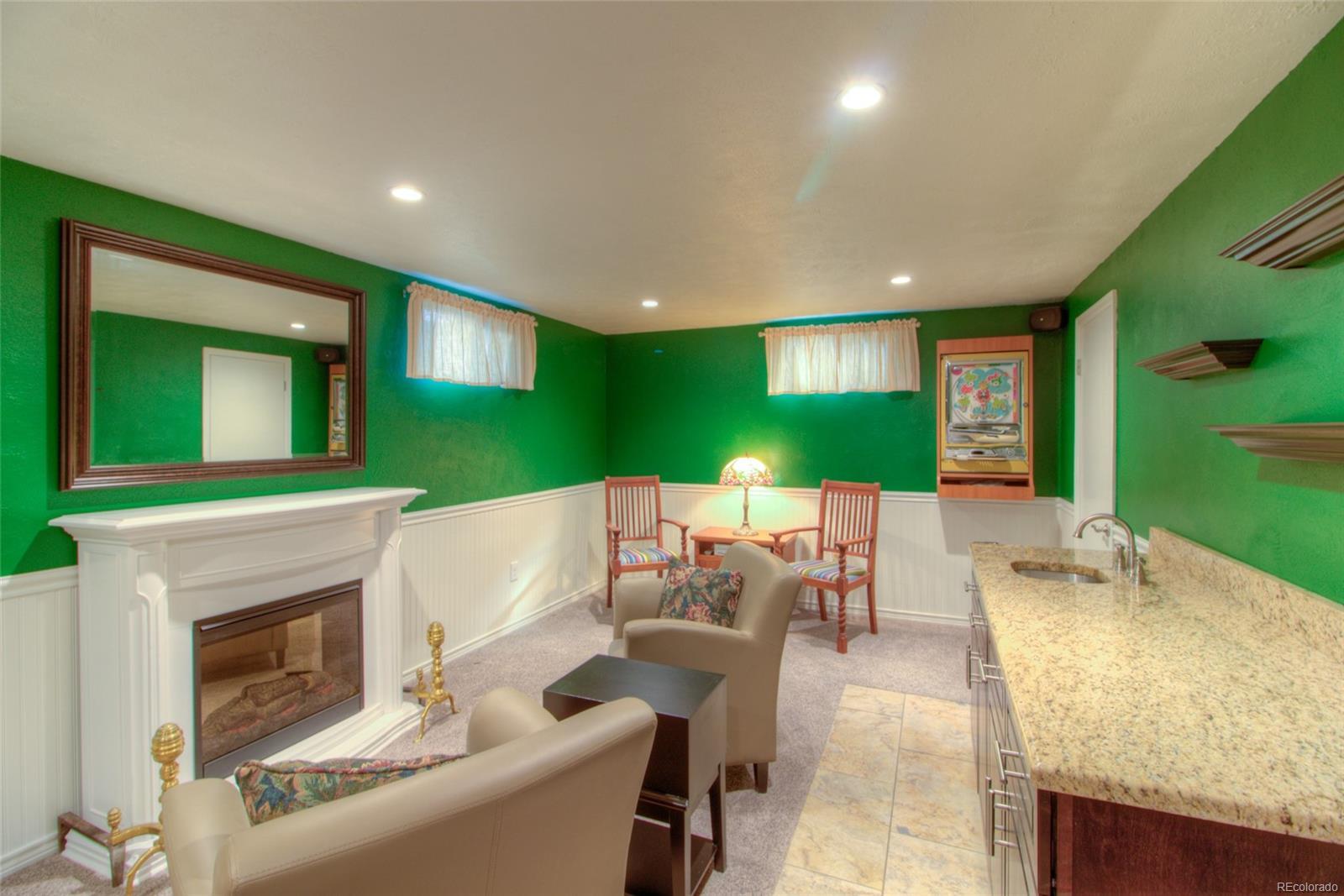 Includes wet bar, new dual pane windows, half bath and two storage room