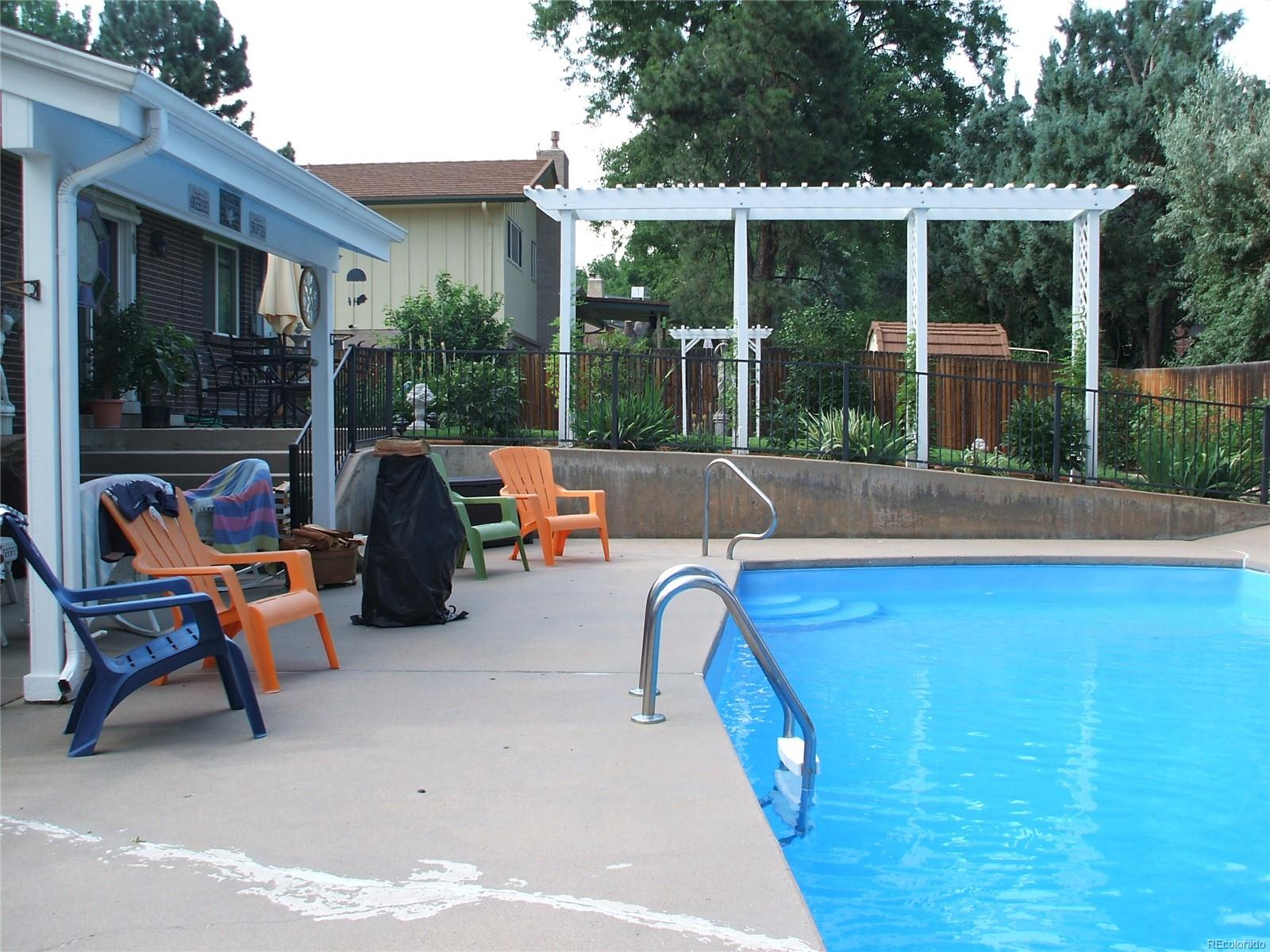 Summer view of this beautiful pool and backyard