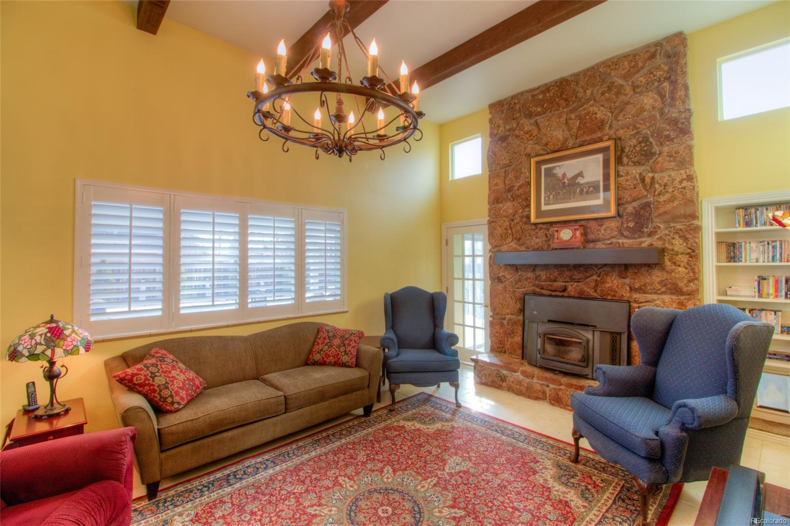 Dramatic Family room with two-story ceiling and wood burning fireplace