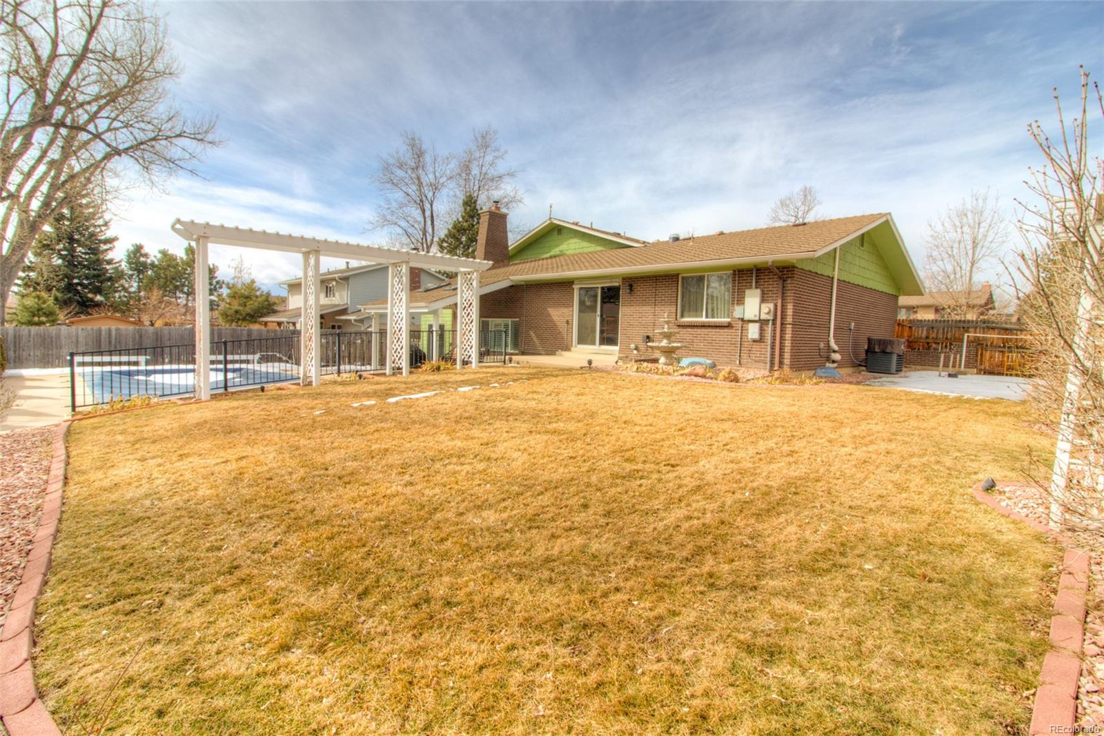 Great backyard with flat grass area too and nice side yard for a garden