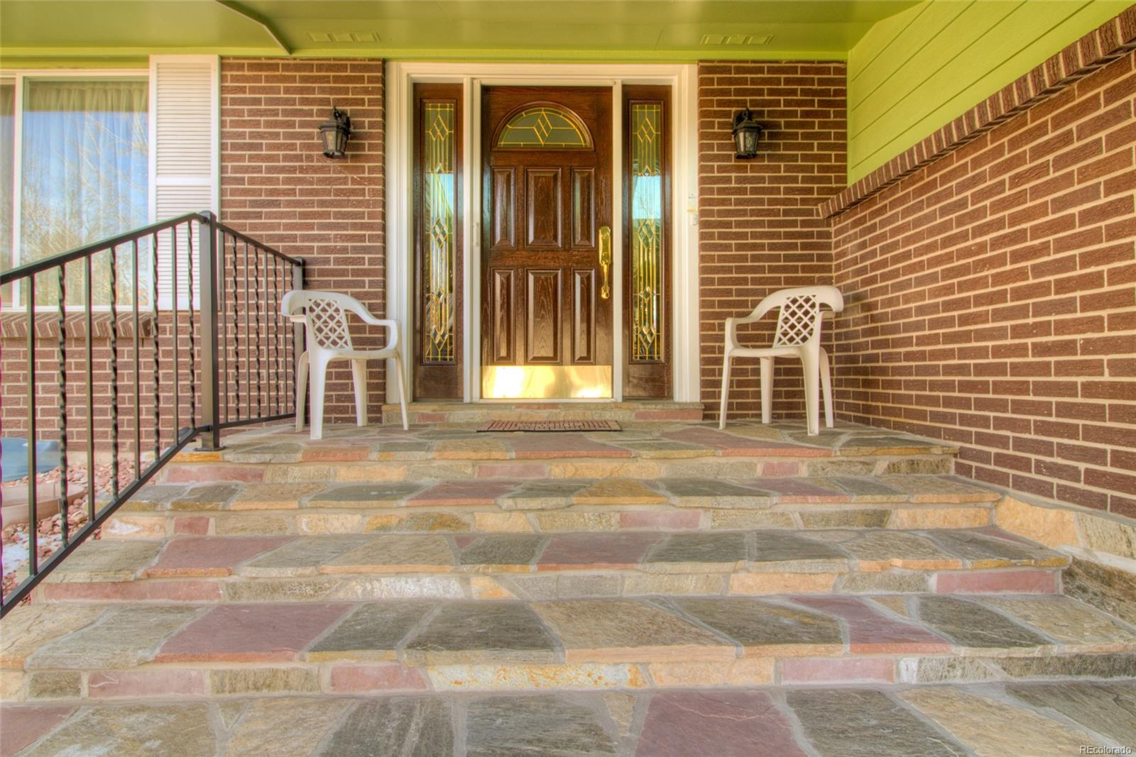 Inviting flagstone covered front porch