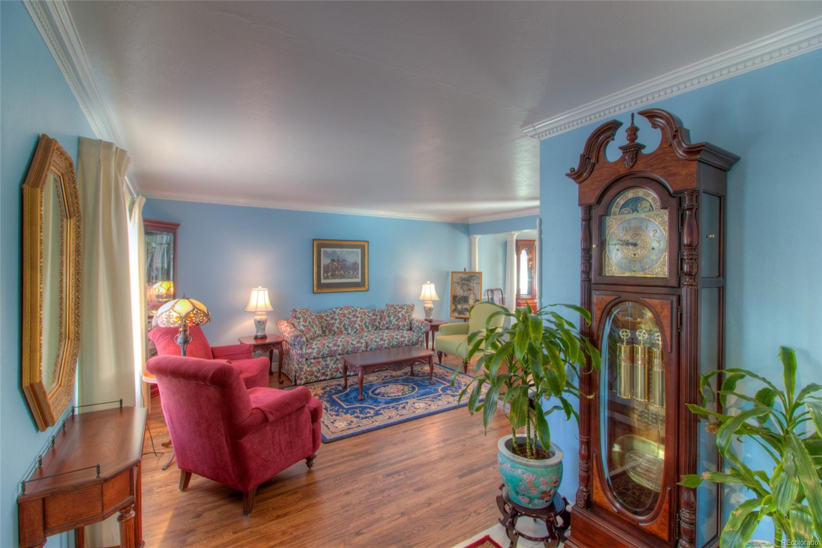 Gorgeous refinished hardwood floors and crown molding in Living Room and Dining Room