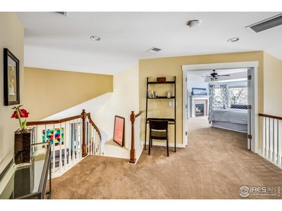 Loft at top of steps separates master from bedroom