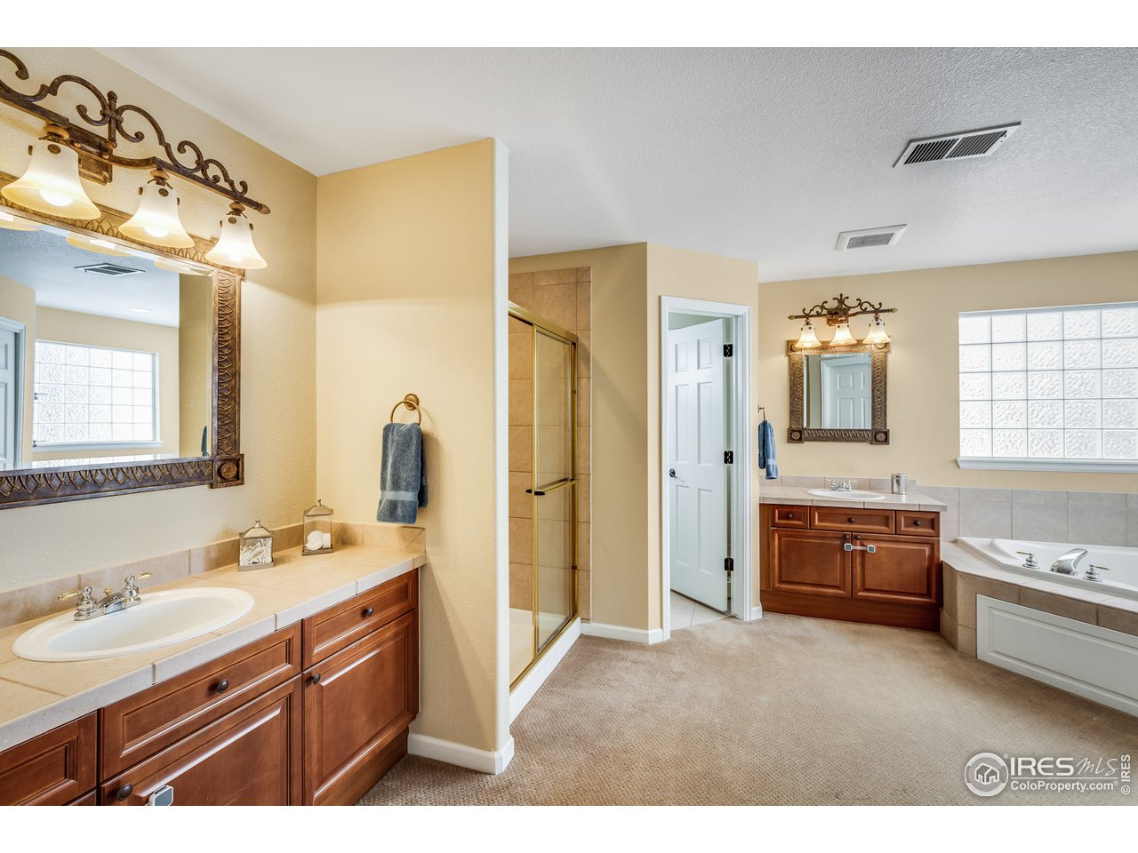 Master bath w/ his & her vanity & closets