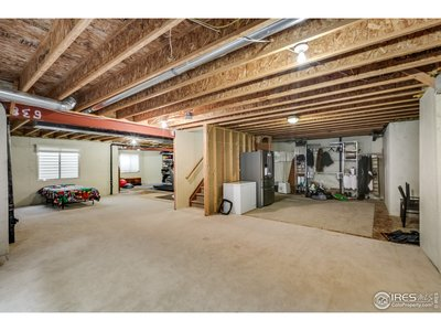 Unfinished basement with high ceilings & windows