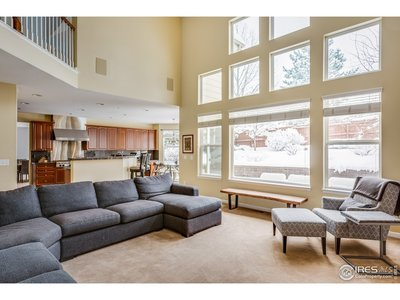 Family room w/floor to ceiling windows