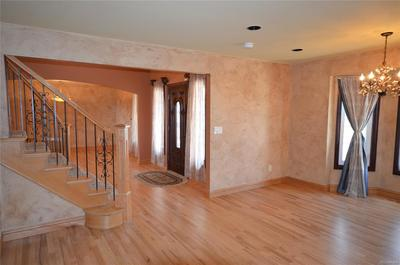 Gleaming hardwood floors throughout the main level, basement and upper level hal