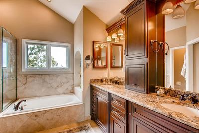 Fully remodeled master bathroom with custom cabinets, enclosed shower with frame