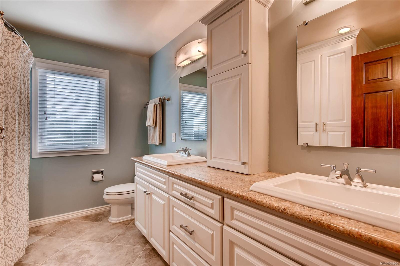 Updated secondary bathroom upstairs with custom cabinets and upgraded hardware a