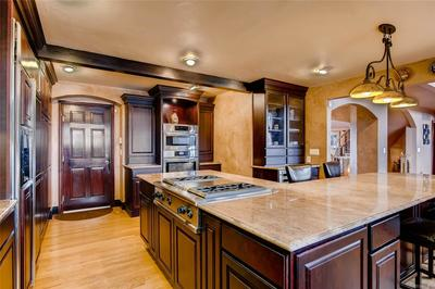 Upper end appliances include Bosch oven and microwave,  Monogram gas range top w