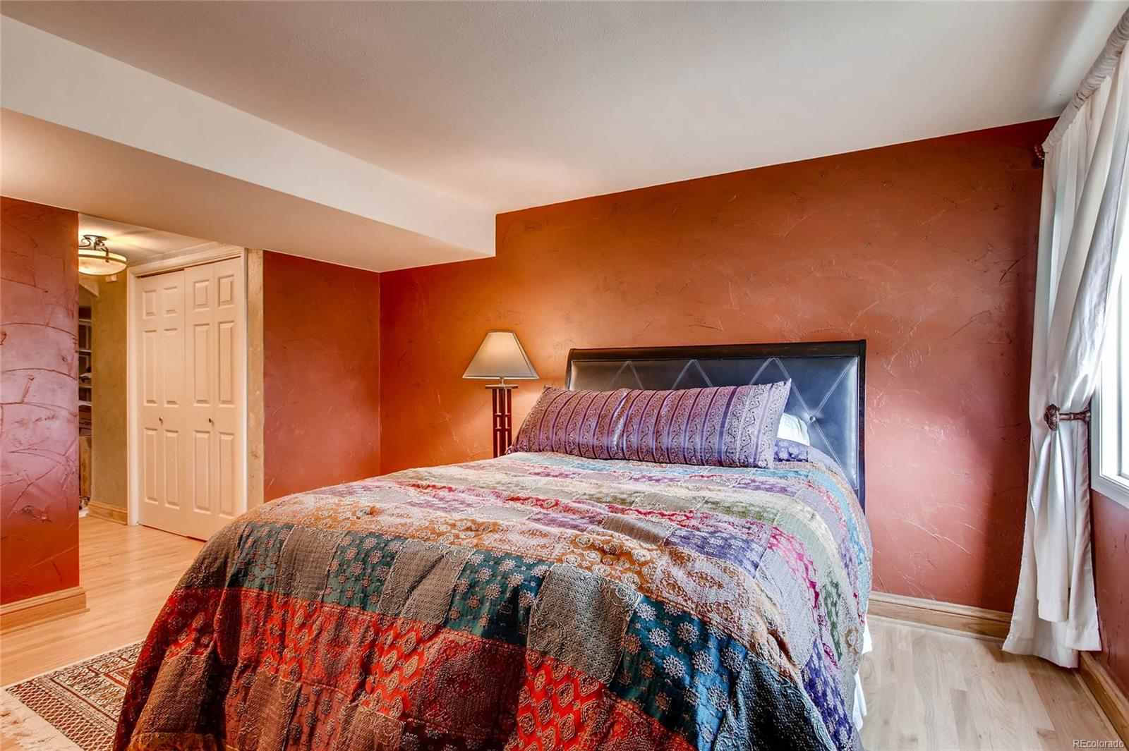 Spacious guest suite with adjacent full bathroom in fully finished basement
