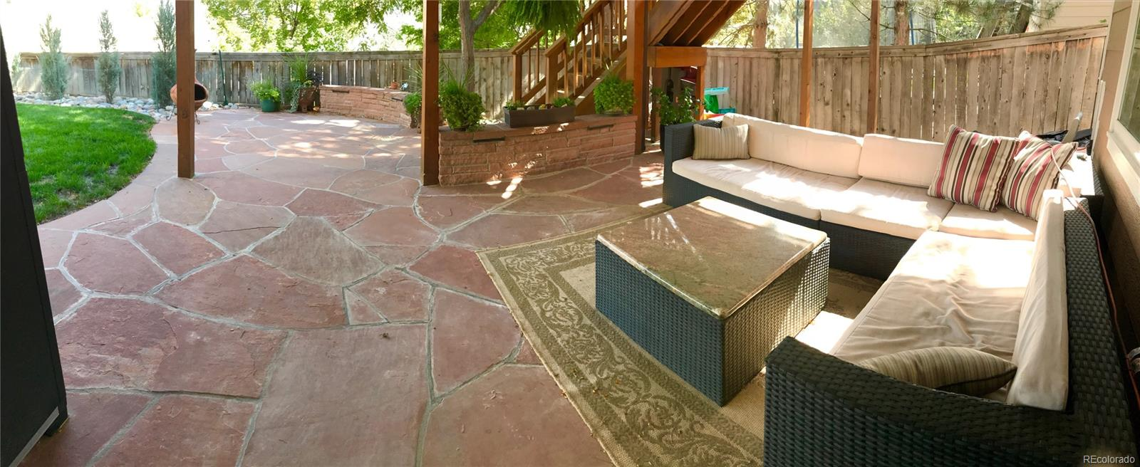 Enjoy Colorado's perfect weather in your back yard oasis complete with flagstone