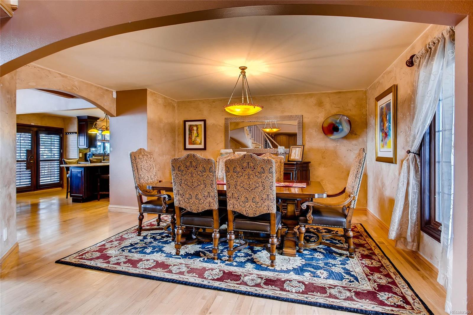Formal dining room with custom imported light fixture