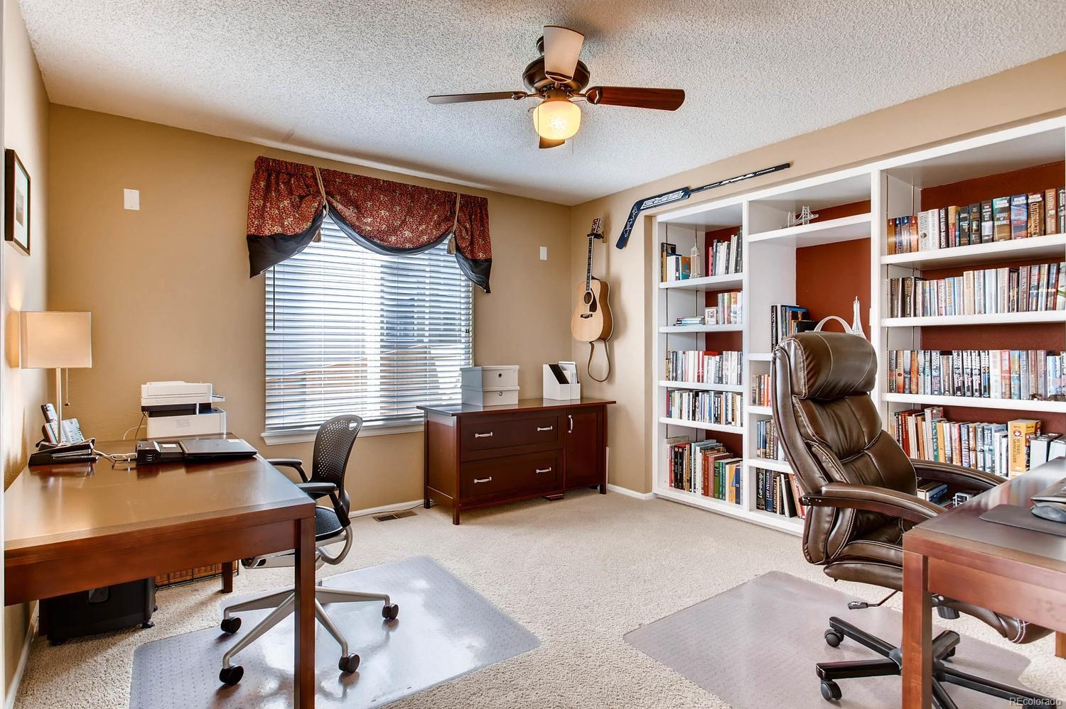 Office with built in bookshelves can be converted into a 4th bedroom if needed