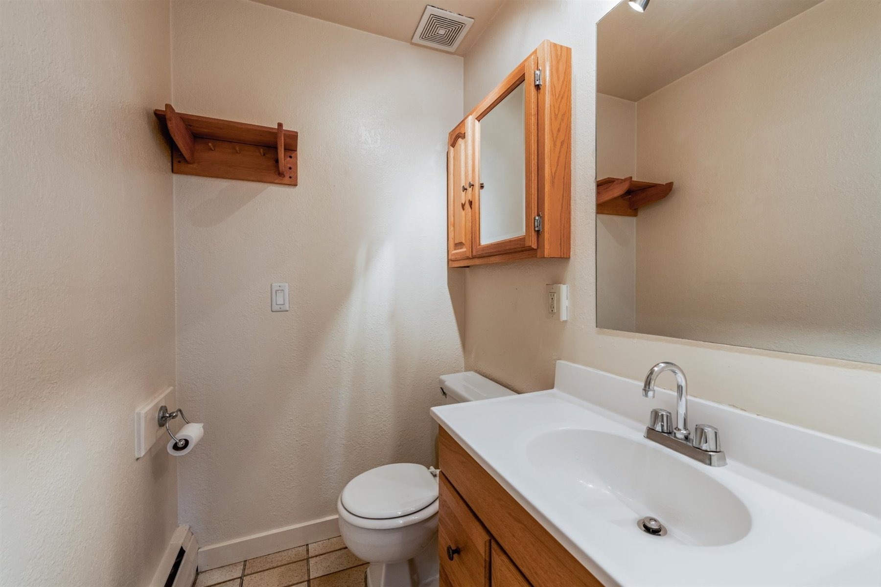 1/2 bathroom connected to bedroom