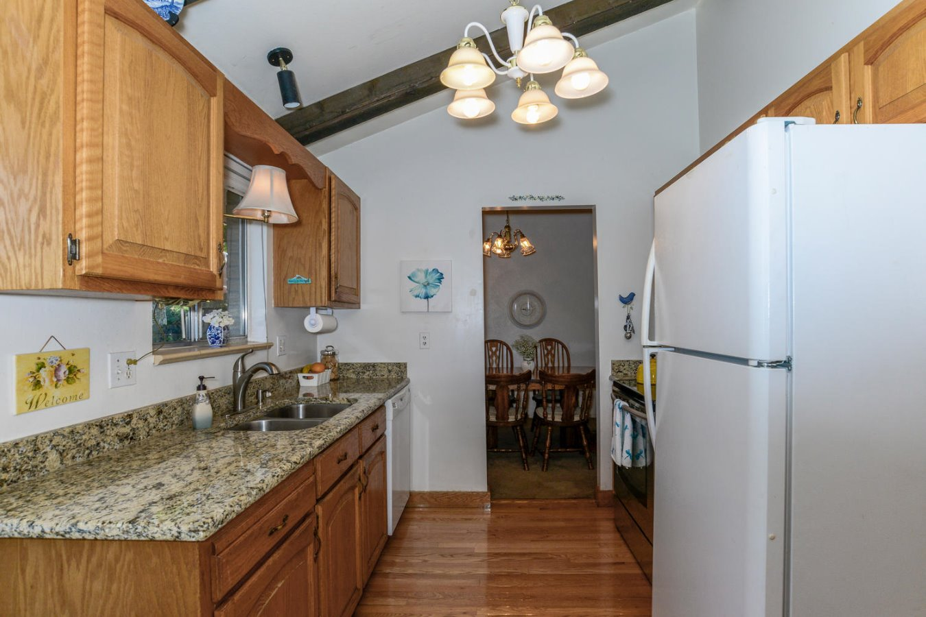 Granite Counters and Hardwood Floors in Kitchen