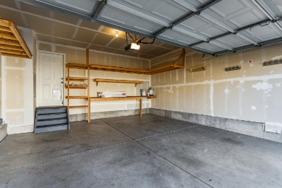 Two Car Attached Garage with Storage Shelving