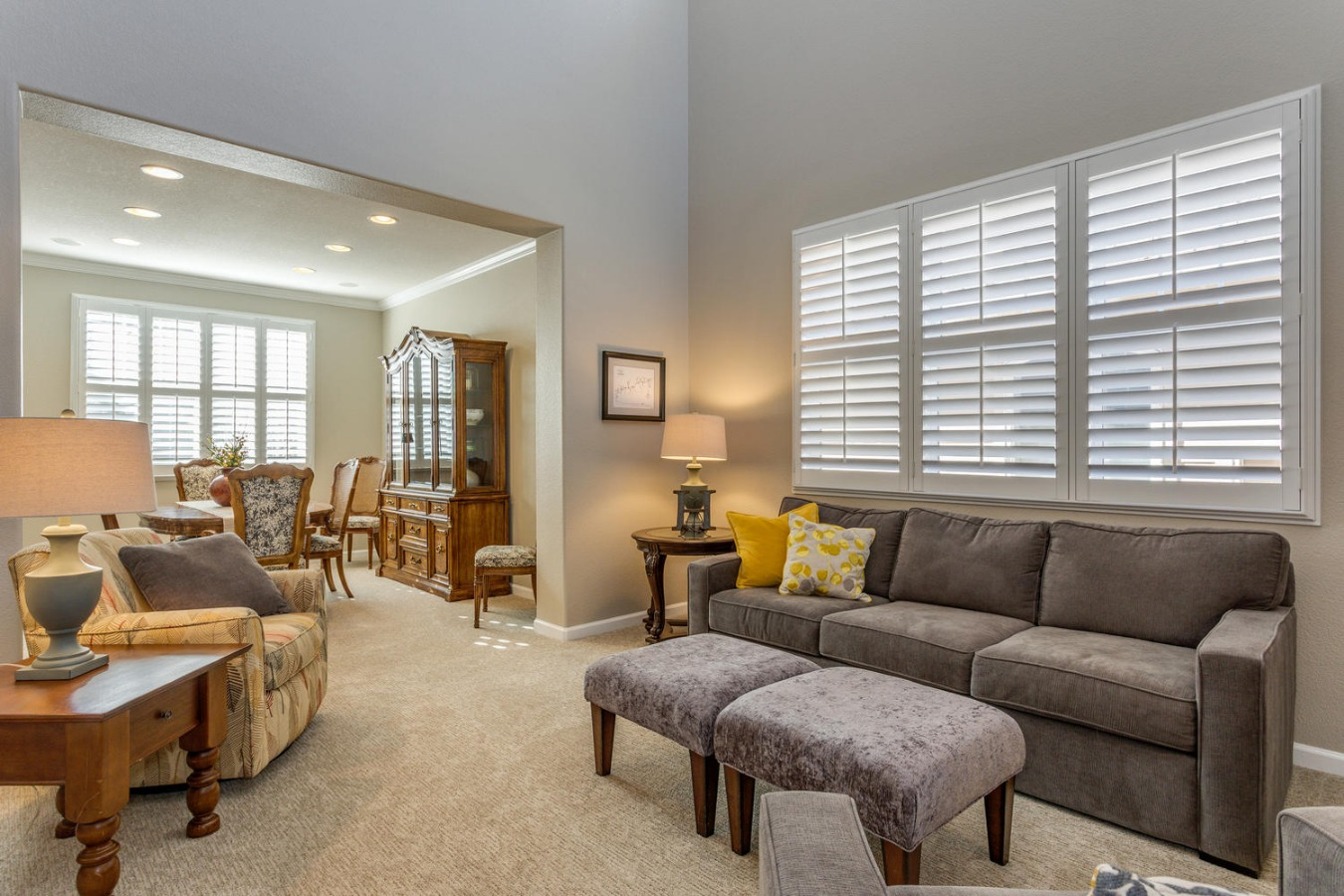 Bright, Open Living Room with Plantation Shutters