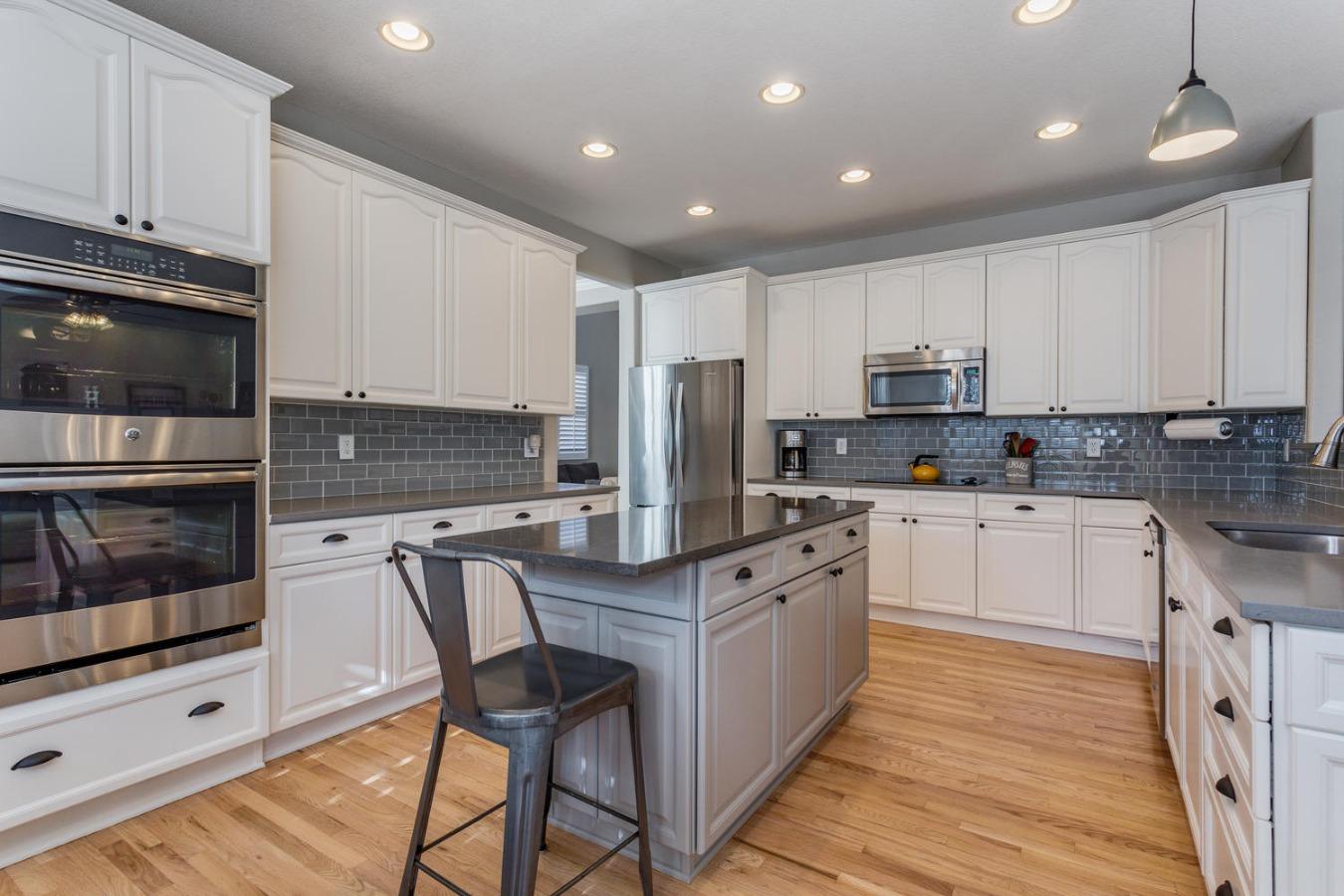 Large Sleek Kitchen with Abundant Cabinetry